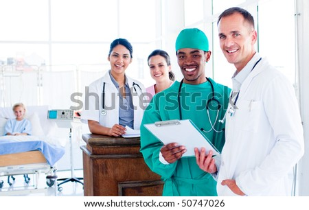 Portrait of a confident medical team at work in hospital - stock photo