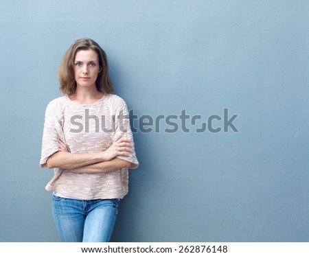 Portrait of a confident mid adult woman posing with arms crossed - stock photo