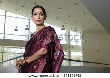 Portrait of a confident middle aged business woman in sari - stock photo