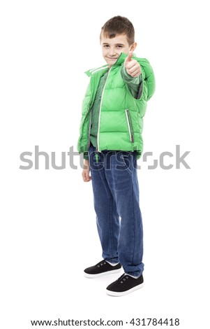 Portrait of a confident school boy showing thumb up isolated on white