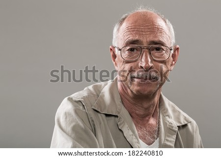 Portrait of a Confident Senior Man with a Smile - stock photo