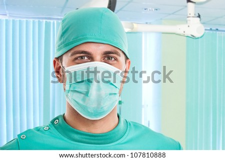 Portrait of a confident surgeon - stock photo