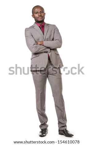 Portrait of a confident young african american business man. Isolated over white. - stock photo