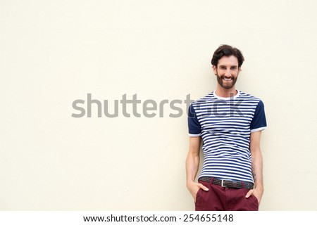 Portrait of a confident young man smiling on white background - stock photo