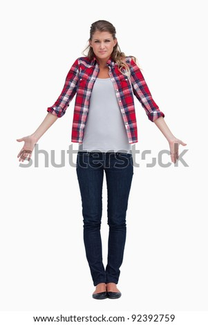 Portrait of a confused young woman against a white background - stock photo