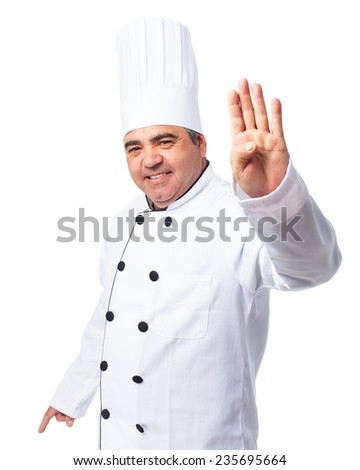 portrait of a cook man doing a number four - stock photo