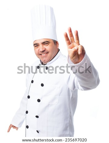portrait of a cook man doing a number three - stock photo