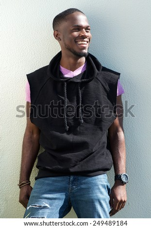 Portrait of a cool african american young man smiling on white background - stock photo