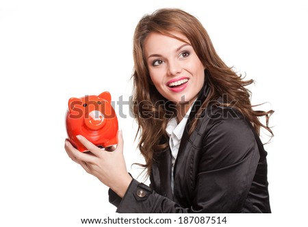 Portrait of a cool beautiful young fashionable brunette with piggy bank.