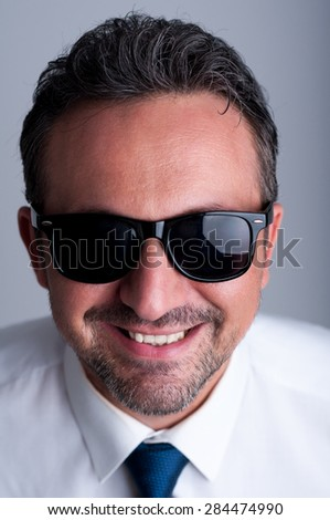 business shades young boy smiling blue sunglasses stock photo 133581338 shutterstock