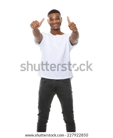 Portrait of a cool guy smiling with thumbs up sign on isolated white background - stock photo