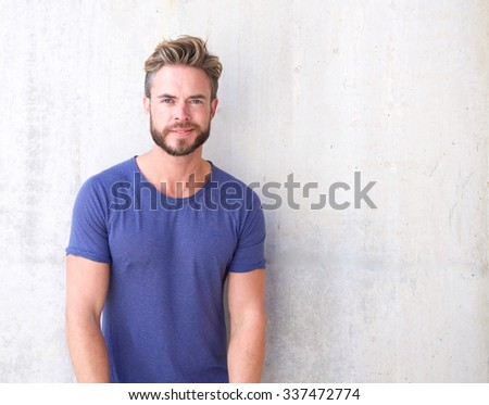 Portrait of a cool guy with beard and purple shirt - stock photo