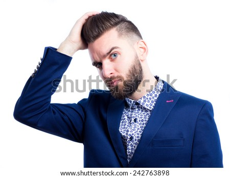 Portrait of a cool young man touching his hair   - stock photo