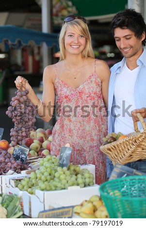 portrait of a couple doing food shopping - stock photo