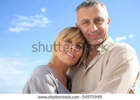 Portrait of a couple embracing - stock photo