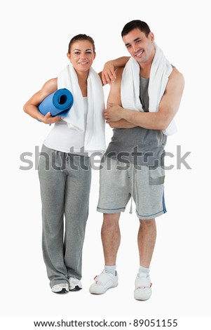 Portrait of a couple going to practice yoga against a white background