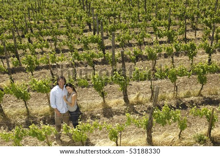 Portrait of a couple in a vineyard - stock photo