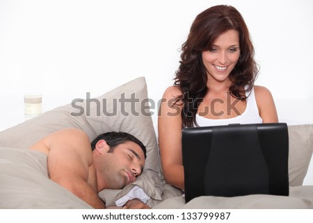 portrait of a couple in bed