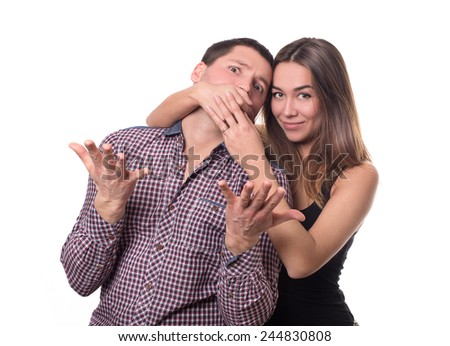 Portrait of a couple of people. relationship. family . quarrel . swearing. she covers his mouth with his hands  - stock photo