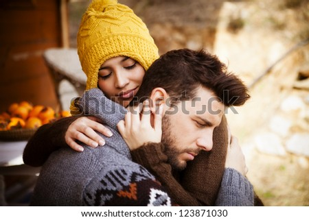 Portrait of a couple, she embrase him with eyes closed - stock photo