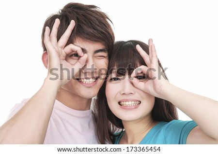 Portrait of a couple showing an OK sign isolated - stock photo