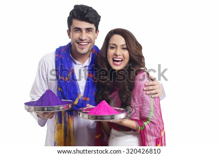 Portrait of a couple with holi colours - stock photo