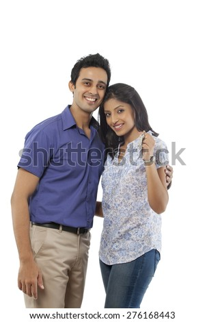 Portrait of a couple with keys smiling
