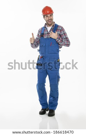 Portrait of a craftsman in workwear clothing with an hardhat on isolated background