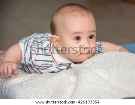 Portrait of a crawling baby in room