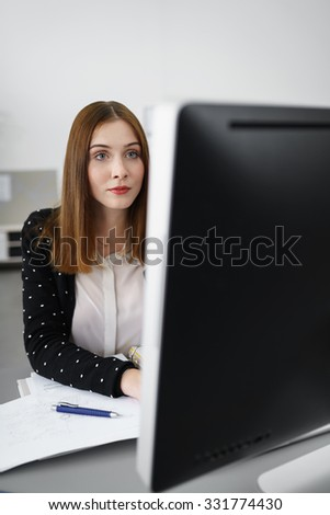 portrait of a creative businesswoman focused on computer screen - stock photo