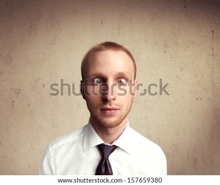 Portrait of a cross-eyed man - stock photo