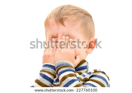 Portrait of a crying boy closeup isolated on white background  - stock photo