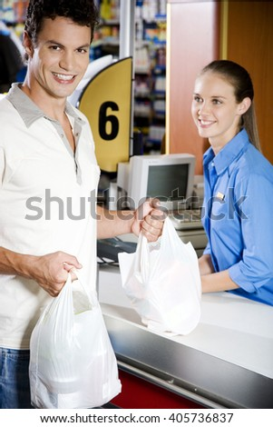 Portrait of a customer and supermarket checkout assistant