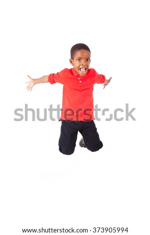 Portrait of a cute african american little boy jumping, isolated on white background - stock photo