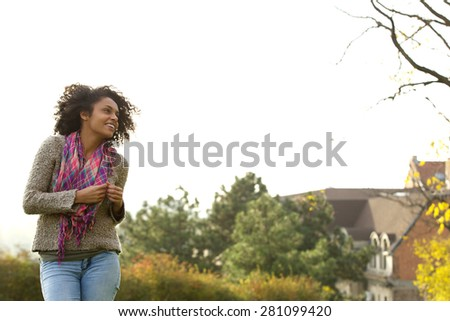 Portrait of a cute african american young woman smiling outside