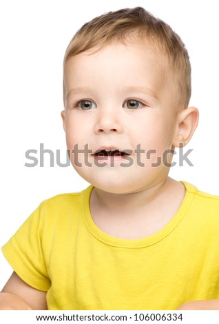 Portrait of a cute and open-mouthed in astonishment little boy, isolated over white