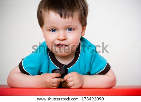 Portrait of a cute and pensive little boy - stock photo