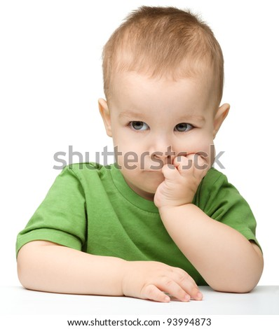 Portrait of a cute and pensive little boy support his head with hands, isolated over white - stock photo