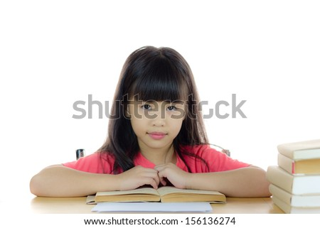 Portrait of a cute asian school girl on the desk, with pile of book