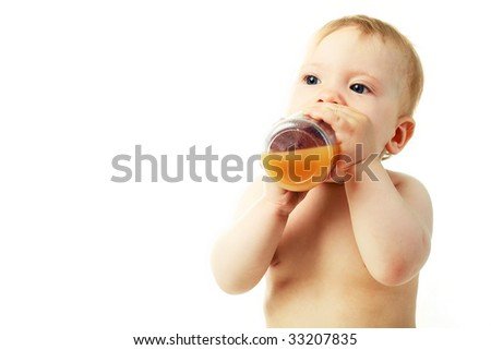 portrait of a cute baby drinking juice