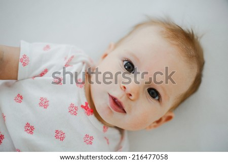 portrait of a cute baby girl. 4 month old. - stock photo