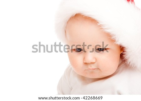 Portrait of a cute baby in a large Santa hat