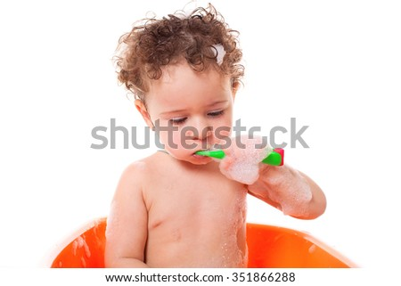 Portrait of a cute baby kid child toddler brushing teeth  - stock photo