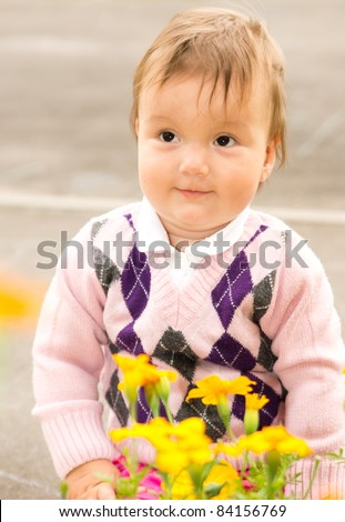 portrait of a cute baby with flowers