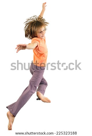 Portrait of a cute barefoot girl jumping and dancing.  Isolated over white background - stock photo