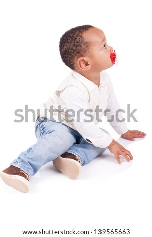 Portrait of a cute black baby boy isolated
