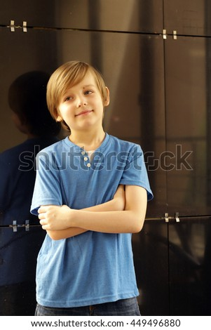 portrait of a cute blond boy in casual clothes  - stock photo