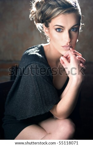Portrait of a cute blonde lady - stock photo