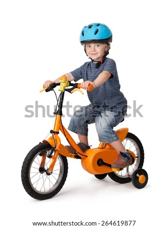 Portrait of a cute boy on bicycle on a white