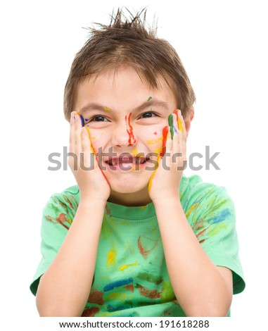 Portrait of a cute boy showing his hands painted in bright colors, isolated over white - stock photo
